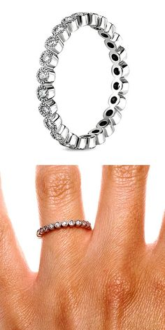 Bezel-set diamonds encircle the finger in this glamorous and whimsical band.