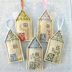 A pretty little lavender bag shaped like a house, with a floral fabric roof and door. A little hand embroidered window and climbing plant give it a cute country cottage look. It is made from an old cream coloured jumper which was felted once it was past repair. The house is 13cm