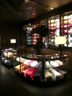 Abercrombie & Fitch - LA. Atmosphere of dark interior with light only on  product.