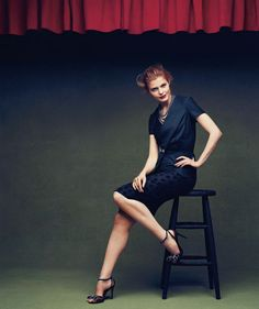 Forties glamour resurfaces in a peplum jacket and a polka-dot skirt to create a modern-day take on suiting.