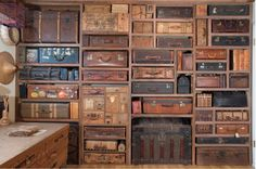 'suitcase wall' from the studio of artist Gail Rieke