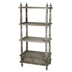 Four-tier wood bookshelf with a distressed finish.  Product: BookshelfConstruction Material: WoodColor:
