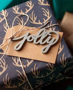 Beautiful christmas wrapping doesn't have to take till New Years Eve to complete! Just tie this silver hand lettered tag to your wonderfully thoughtful gift, and spend that extra time watching ELF for
