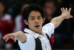 MOSCOW, RUSSIA. NOVEMBER 14, 2014. Takahiko Kozuka of Japan performs during the men's short program at the 2014 Rostelecom Cup, the fourth of six events in the 2014-2015 ISU Grand Prix of Figure Skating, at Luzhniki Small Sports Arena. Valery Sharifulin/TASS