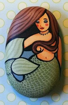 Mermaid painted rock - I love painting rocks when we go camping. This blog has beautiful examples.
