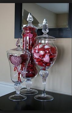 This is a beautiful simple table or hallway design for Valentines Day! Reuse those beautiful apothocary jars that you had for the Christmas holiday. Simple and elegant!