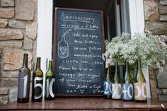 Seriously the cutest idea ever:  Guestbook: Messages in a bottle for each major anniversary. Bottle is broken open and messages from guests are read.