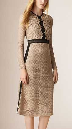 Burberry silk-lined sheer lace dress with macramé bib detail. Contrast colour mesh panels highlight the feminine waistline and A-line silhouette. Discover the women's dress collection at Burberry.com