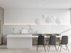 Białe lampy kule nad stołem w kuchni w stylu minimalistycznym