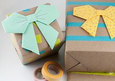 Instead of store-bought bows, try these origami alternatives. It's a simple way to dress up your kraft paper.