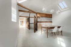 Rustic dining room with contemporary Eames chairs