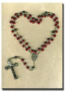 I'm not catholic...and I know you aren't supose to wear them....but I love a pretty rosary as a neckalace....it's just a beautiful cross to me. :)