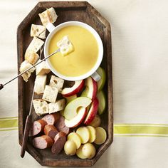 At-Home Date Night: Cheddar Beer Fondue. Serve with assorted bread cubes, potatoes, soft pretzel bites, and veggies.we purchased a fondue set years ago at crate and barrel out in Minnesota. Fondue Recipes, Appetizer Recipes, Cooking Recipes, Fondue Ideas, Easy Recipes, Cheese Fondue Dippers, Cookbook Recipes, Copycat Recipes, Snacks