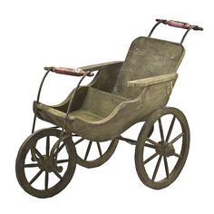 "Colorfully hand painted and distressed antique wooden baby stroller. This item is hand crafted by artisans from Rajasthan. - * Material: Antiqued black iron and distressed wood - * Size: 38""(L) X 18""("