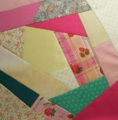 Step by step crazy quilt instructions, using the stitch and flip, (with a foundation fabric) method.  Similar to paper piecing, but no real picture emerges.  The quilts were originally not intended for use, and silks and satins were used to make the blocks.  Then, the blocks were embellished with embroidery, to show off the maker's needlework skills.