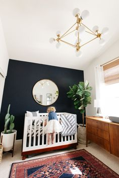 LEVIS NURSERY REVEAL 2019 a sister and brother moment // boy nursery with dark navy accent wall ornate rug fiddled fig tree bubble chandelier and mid-century credenza Baby Bedroom, Baby Boy Rooms, Baby Boy Nurseries, Nursery Room, Boy Nursery Rugs, Nursery Daybed, Unisex Baby Room, Boy Nursery Colors, Modern Nurseries