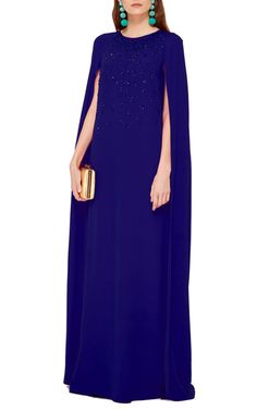 This **Oscar de la Renta** caftan features a round neck, a jewel embellished bodice, and a cape inspired silhouette with structured shoulders.