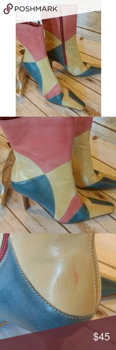 Vintage patchwork stiletto boots Gorgeous multi color patchwork boots. These are in amazing vintage condition. One noticable mark is pictured. They are sized an 8.5 but run small and are narrow. So would fit a 7.5 better. Vintage Shoes Ankle Boots & Booties
