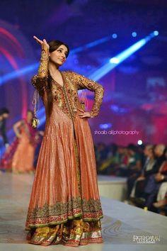 Soha Ali Khan walks the ramp in a bridal lehenga with coat