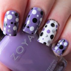 Purple nails with polka dots