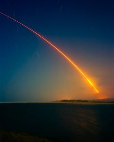 An unarmed Minuteman III nuclear missile is launched from Vandenberg Air Force Base in California. The missile travelled 5250 miles. by Simon Norfolk.