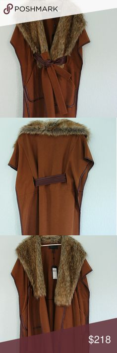 """BCBG MAX AZRIA cape I originally bought it and hoped to use it as a gift for someone, but that never happened, so this cape is 100% new, never be worn. It's been hanging in my closet and protected in a bag.  This wool cape features a faux-fur shawl collar and a single-button closure. Faux leather trim and slant hip pockets. Self-belt at waist. Short sleeves. it's quite versatile. Can be worn over one thin piece of clothing in warmer weather or worn over thick layers in cold days.   36"""" long…"""