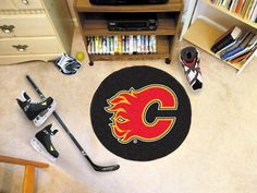 The NHL - Colorado Avalanche diameter Hockey Puck-shaped area rug by Fan Mats, Proudly Made in U. Made of nylon carpet and non-skid recycled vinyl backing. This rug is machine washable and Officially licensed. Chromojet printed in true team colors. Minnesota Wild Hockey, Pittsburgh Penguins Hockey, Blackhawks Hockey, Hockey Puck, Chicago Blackhawks, Panthers Hockey, Jets Hockey, Colorado Avalanche, Ducks Hockey