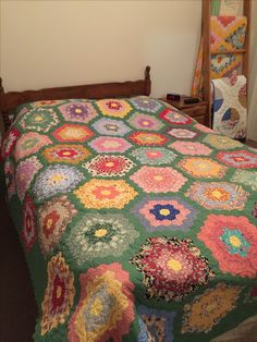 Vintage Grandmother's Flower Garden quilt, very similar to mine.
