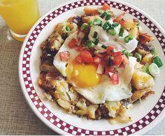 eggs on potato hash with salsa
