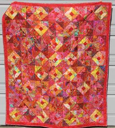 My first quilt inspired by Kaffe Fassett, using many of his fabrics. :)