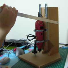 Rotary Tool Drill Press by The Fickle Tinkerer -- Homemade rotary tool drill press constructed from MDF. http://www.homemadetools.net/homemade-rotary-tool-drill-press-2