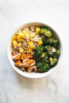 A nutritious make-ahead meal prep idea: Sweet potato buddha bowl with the creamiest sweet almond butter dressing served over mango coconut brown rice.