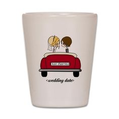 A cute little cartoon brunette groom and blonde haired bride sitting in a red wedding car with a license plate that reads: Just married.