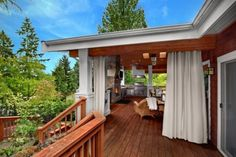 I like this porch/deck.  The curtains that can be pulled for privacy or sun block.