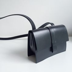 The Kim leather black box bag by Danielle Foster…