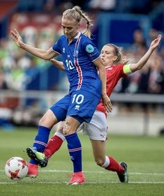 Lara Dickenmann #11 of Switzerland and Dagny Brynjarsdottir #10 of Iceland battle for the ball during the UEFA Women's Euro 2017 Group C match between Iceland and Switzerland at Stadion De Vijverberg on July 22, 2017 in Doetinchem, Netherlands.