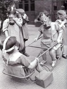 Children Play Wearing Gas Masks, historical world war 2 ,home front photography social art Old Pictures, Old Photos, Old Pics, Interesting History, Interesting Photos, Vintage Photographs, Funny Vintage Photos, Historical Photos, Belle Photo