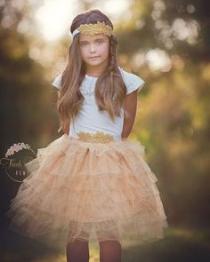 "A Golden Christmas! ✨ Our ""Golden Sunrise"" tulle skirt is so beautiful and full of layers of sparkly gold tulle! Perfect for al her Christmas parties! #goldenchristmas #thinkpinkbows #christmasoutfit #fashionkids"