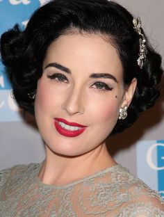 Old Hollywood glamour makeup - deep red lips, heavy brows, long, dark lashes. Love the bling pin in her hair too