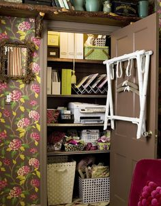 A closet ready for guests, with hangers, luggage rack and hooks, etc.