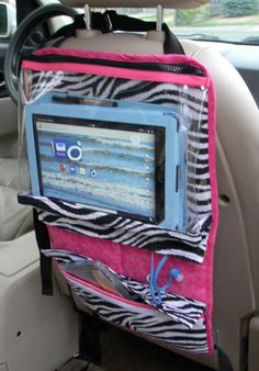 This custom made IPad or tablet organizer can be used by children and teens alike. With pockets for CDs, pens, ear buds and etc. It has adjustable