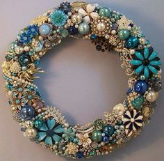 Elegant Christmas Wreath covered in Costume Jewelry, Pins, or Broaches!!! Bebe'!!! Love the Shades Of Blue and Pearls!!!