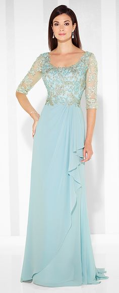 Chiffon A-line gown with hand-beaded lace illusion three-quarter length sleeves, front and back scoop necklines, beaded lace bodice, side draped skirt with cascading ruffle and center back gathers, sweep train.