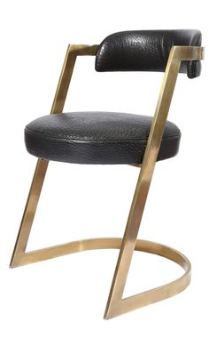KELLY WEARSTLER | STUDIO DINING CHAIR. A glamorous mix of bronze and leather.
