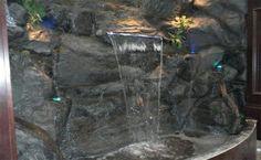 Indoor Rock Waterfall  http://www.waterfallnow.com/