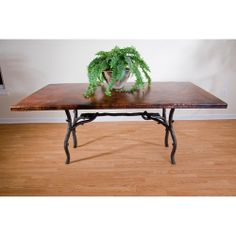 "Copper table with wrought iron ""branch"" legs."