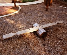 This low-to-the-ground Log Seesaw is perfect for toddlers. Because the seesaw board pivots on a small log at its center point, there is no fall zone required. Kids Outdoor Play, Outdoor Play Spaces, Kids Play Area, Outdoor Learning, Backyard For Kids, Outdoor Fun, Backyard Ideas, Outdoor Toys, Outdoor Ideas