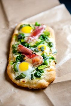 You might normally top your pizza with extra cheese, pepperoni, or mushrooms, but have you tried topping your pizza with an egg? I'm particularly enamored of fried eggs on pizza because you get that luxurious runny yolk that mixes in with the cheese and tomato sauce. In some cases, adding an egg to pizza even allows you to pass it off as breakfast. And who doesn't love pizza for breakfast? If you're looking for ideas, here are 12 ways you can top your pizza with an egg.