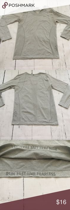 """Nike Dri-Fit Running Top In good condition but last photo shows some piling under armpit area. No rips, stains or tears. Smoke free home. Measures almost 17"""" across from armpit to armpit and is 24"""" in length. Those measurements were taken without stretching. Nike Tops"""