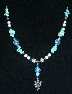 Custom order necklace...Turquoise, Blue crystals, glass pearls, blue glass discs, silver-tone beads, and a silver-tone fairy pendant.